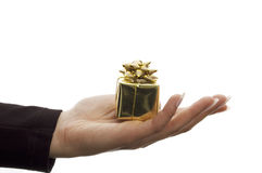 Gift in hand. On white stock images