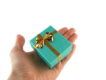 Gift in a hand. Gift packing on white stock photos