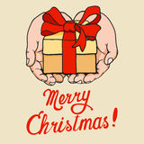 Gift in hand on Christmas Royalty Free Stock Image
