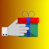 Gift in hand. Isolated gift and hand on the gradient background Royalty Free Stock Photography