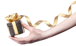 Gift in hand isolated on white background Royalty Free Stock Photo