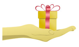 Gift in hand Royalty Free Stock Photography