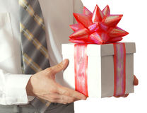 Gift in hands of the businessman Stock Photography
