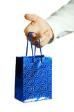 Gift in hands of the businessman. The businessman offering to you a gift Royalty Free Stock Photography