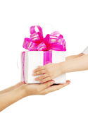 Gift in hands of mum and the child Royalty Free Stock Images