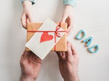 Gift in the hands of a youngest daughter royalty free stock photo