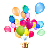 Gift hanging on color balloons Stock Photo