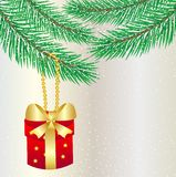 Gift hangs on a christmas tree Royalty Free Stock Photos