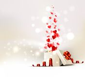Gift with heart. Background with opening gift of Valentine's day Stock Photo