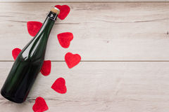 Gift , the heart and the bottle of red wine for a romantic holiday Valentine`s day stock image