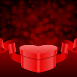 Gift heart with ribbon and light Stock Photo