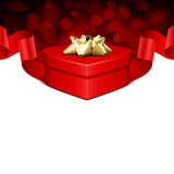 Gift heart with ribbon and light Stock Photography