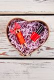 Gift in heart-shaped box Stock Photo