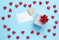 Gift and hearts on blue background Royalty Free Stock Image