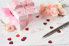 Gift, hearts and greeting card Stock Image