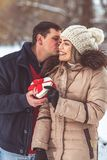 Gift hearts - Man gives a box with a gift to his girlfriend for valentines royalty free stock photo