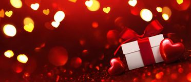Gift with Hearts on Red Background Royalty Free Stock Photography