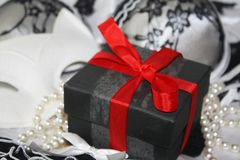 Gift for her, sensual christmas or valentine birthday present with a red ribbon, glamour erotic style. Image royalty free stock photo