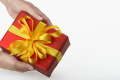 Gift holding in hands Royalty Free Stock Photography