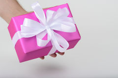 Gift holding in hands Royalty Free Stock Image