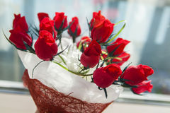 Gift for the holiday bouquet of red roses Stock Image