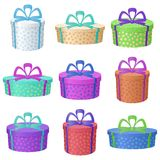 Gift holiday boxes. Set multi coloured round gift boxes with a patterns and bows, isolated on white background Stock Photography