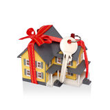 Gift house and key with clipping path. Gift miniature house with red ribbon and key isolated on white background - Including clipping path Stock Photo