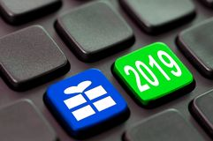 2019 and a gift icon on a computer keyboard. 2019 and a gift icon written on a computer keyboard royalty free stock photos
