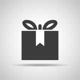 Gift icon with shadow on a gray background. Vector illustration Stock Image