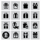 Gift icons. Vector black gift icon set on gray stock illustration