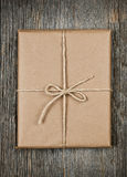 Gift In Brown Paper Tied With String Royalty Free Stock Photos