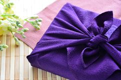 Gift In Cloth Wrapping Royalty Free Stock Photography
