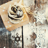 Gift with Jingle Hand Bell and Natural Twine Royalty Free Stock Images