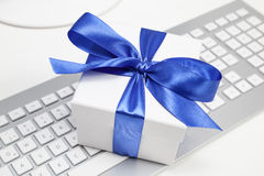 Gift on keyboard Royalty Free Stock Image