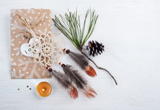 Gift kraft bag and beige dream catcher Royalty Free Stock Image