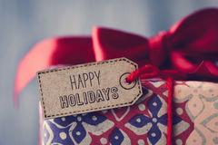 Gift with a label with the text happy holidays Stock Photo