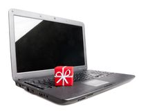 Gift on a laptop Stock Images
