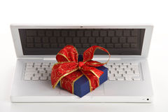 Gift on laptop computer Royalty Free Stock Image