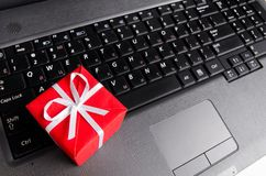 Gift on a laptop keyboard Royalty Free Stock Photo