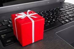 Gift on a laptop keyboard Stock Photos