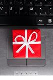 Gift on a laptop keyboard Royalty Free Stock Photography