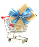 Gift with light blue bow in the shopping cart Royalty Free Stock Images