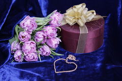 Gift.Light violet tulips, box, heart of gold chain Royalty Free Stock Image