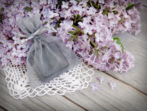 Gift and lilac on wood Stock Images
