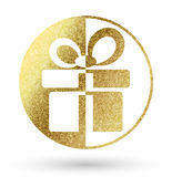 Gift logo. In bright gold Royalty Free Stock Photo