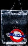 Fall down. Gift from London fall down in to glass of water Stock Photo