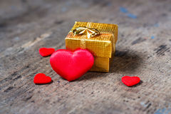 Gift and a lot of hearts Royalty Free Stock Photography