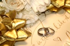Gift of love. Bride and grooms rings on gift paper Stock Images