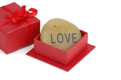 Gift of Love. Stone engraved with love in a red gift box Stock Photography