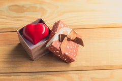 Gift of love. hearty gift. A gift box with a red heart inside. Royalty Free Stock Photo